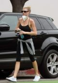 Charlotte McKinney wraps up a yoga class and picks up some flowers and eggs at a Farmers Market in Los Angeles
