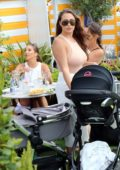 Chloe and Lauryn Goodman enjoy lunch with their newborn babies and their mum and sister Amelia in London, UK