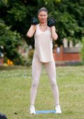 Chloe Sims sweats it out during an outdoor workout session with her personal trainer in Essex, UK