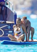 Christina Milian wears a white swimsuit as she enjoys a day with Matt Pokora on a yacht in Saint-Tropez, France