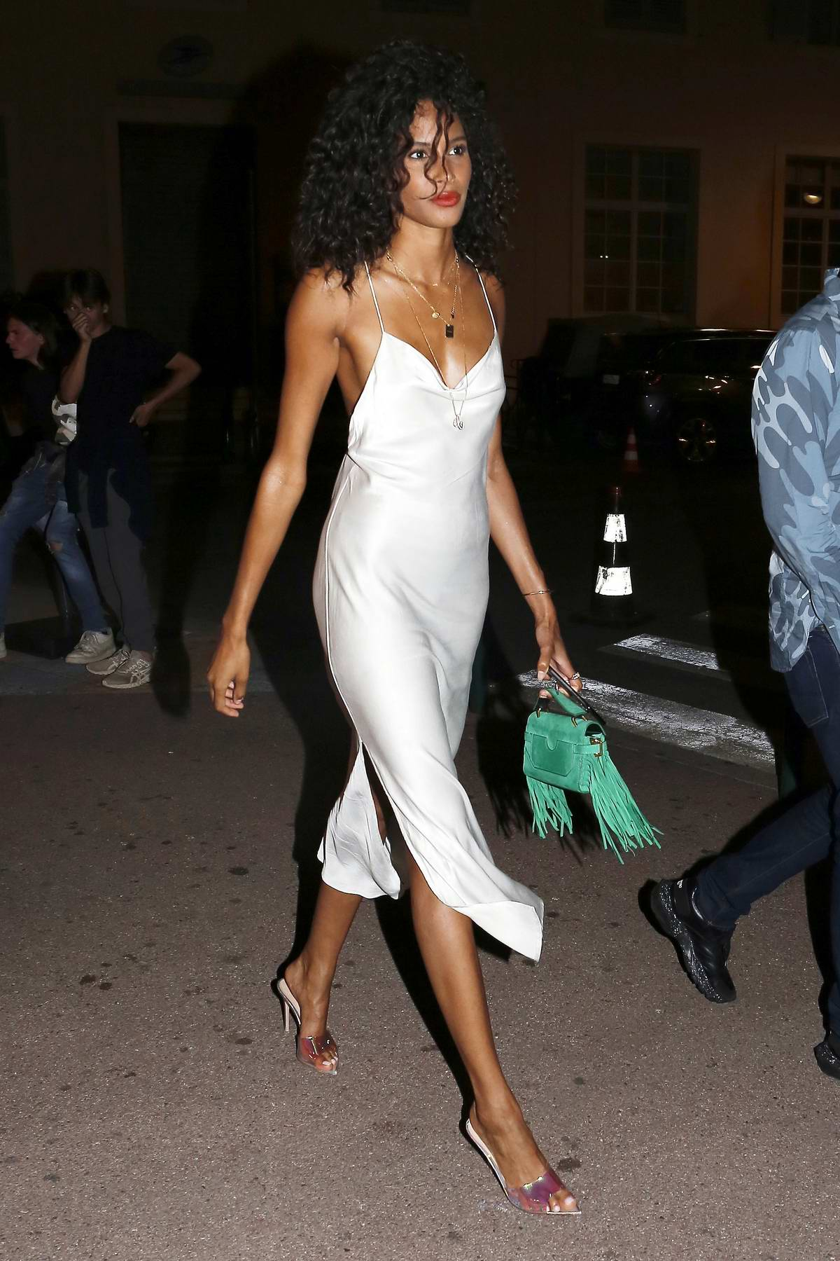 Cindy Bruna looks amazing in a white satin dress as she arrives at VIP Room La Gioia in Saint-Tropez, France