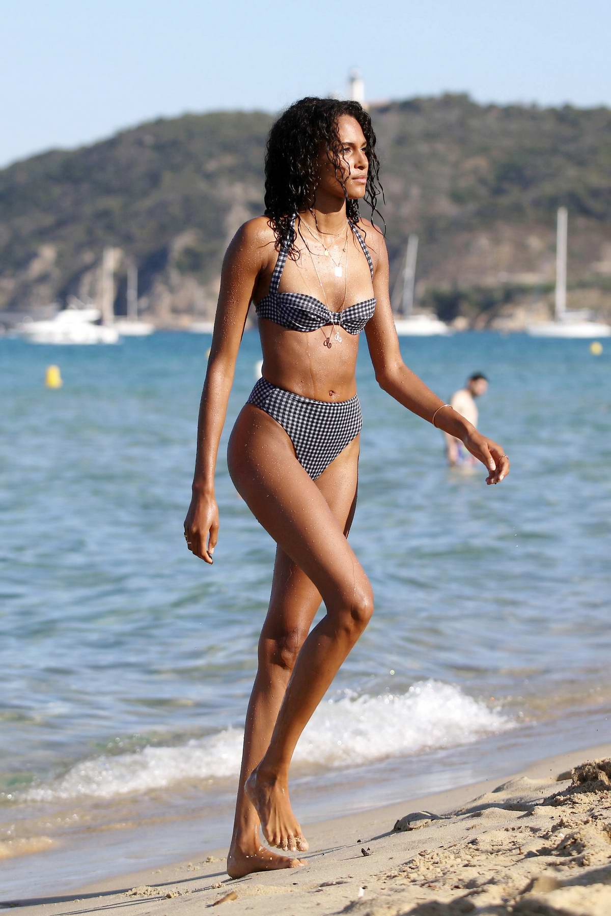 Cindy Bruna wears gingham pattern bikini while enjoying a day with her sister at Verde Beach in Saint-Tropez, France