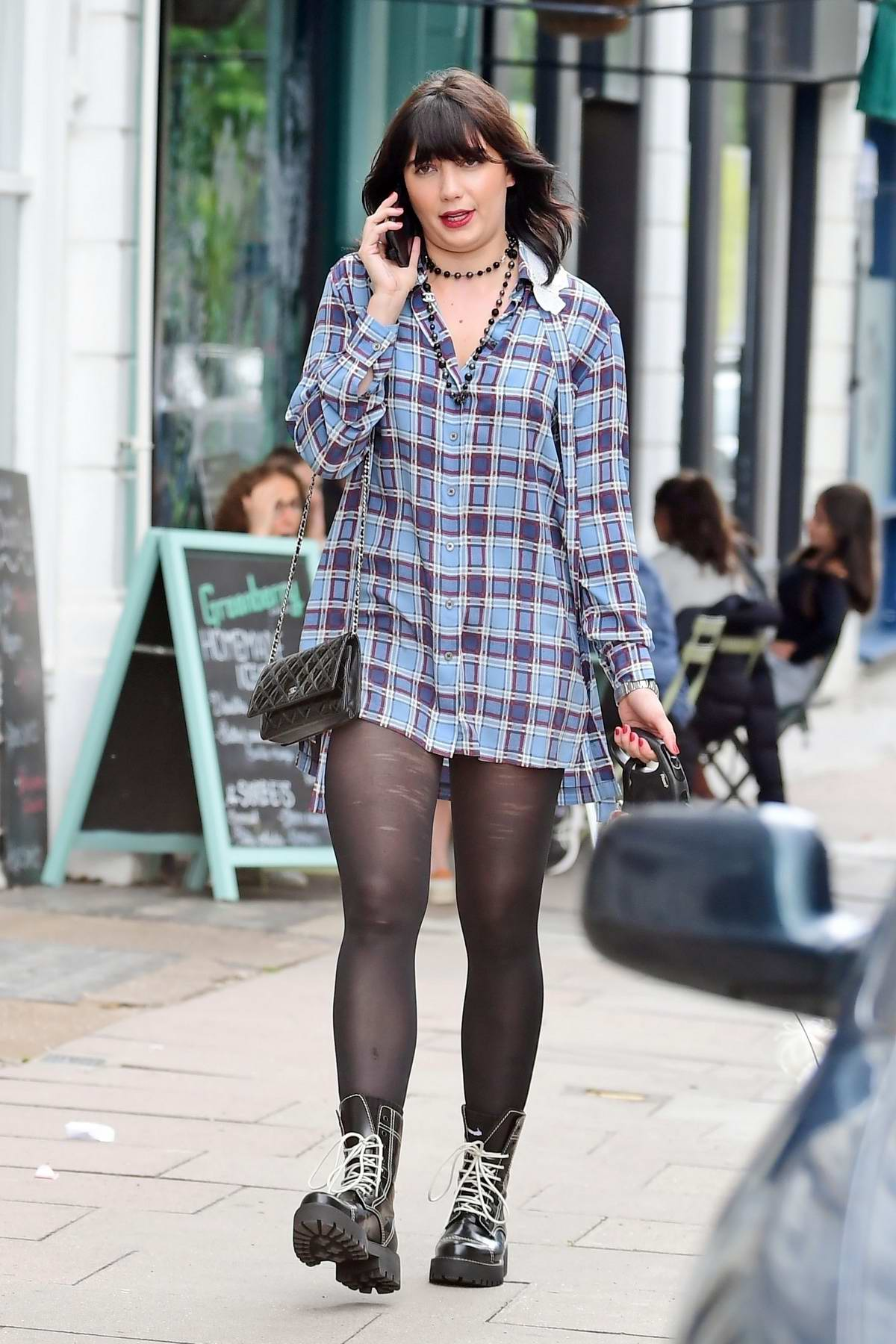 Daisy Lowe looks in good spirits while out walking her dog in Primrose Hill, London, UK