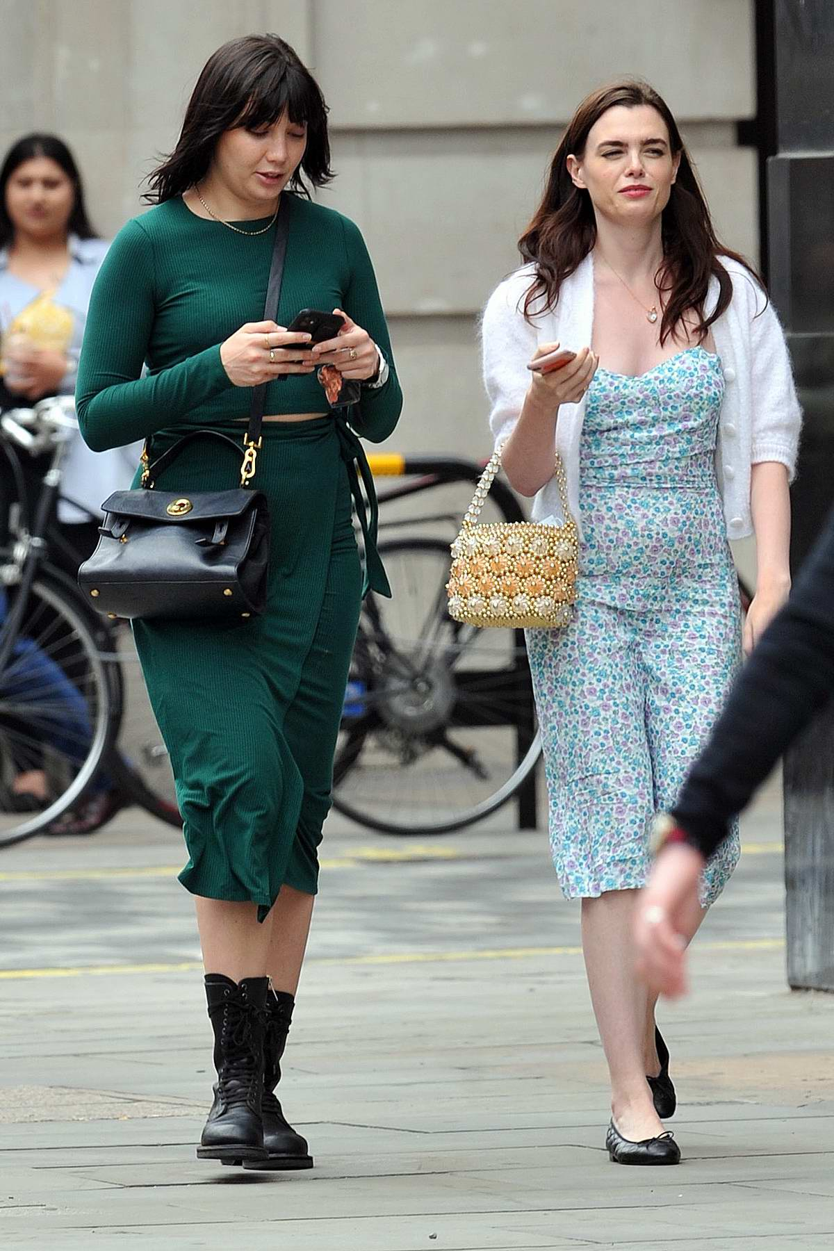 Daisy Lowe wears a form-fitting green dress during a shopping trip with Charli Howard in London, UK