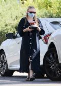 Dakota Fanning picks up some food to-go from her new home in Los Angeles