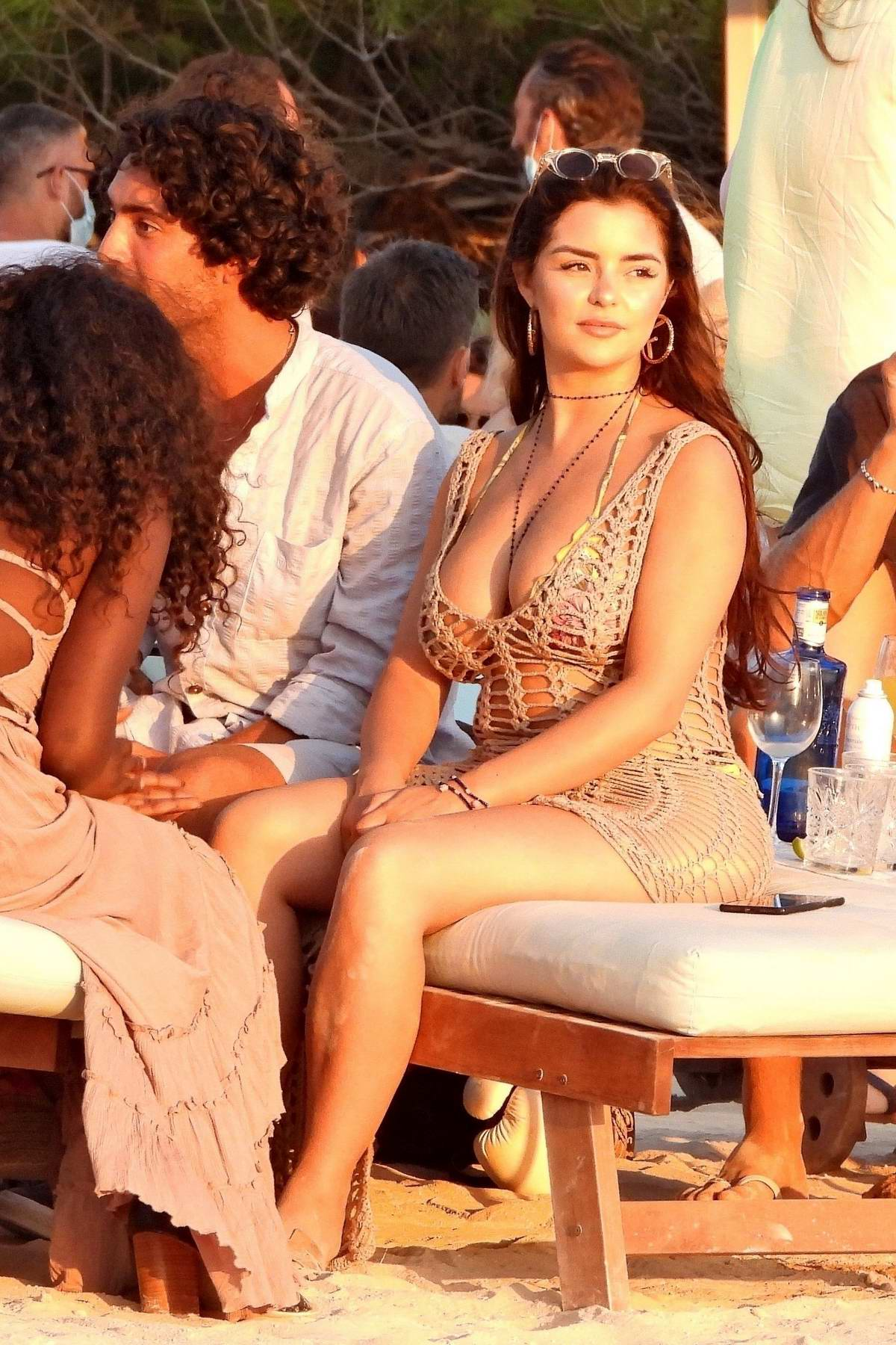 Demi Rose enjoys the sunset with friends at Experimental Beach in Formentera, Spain