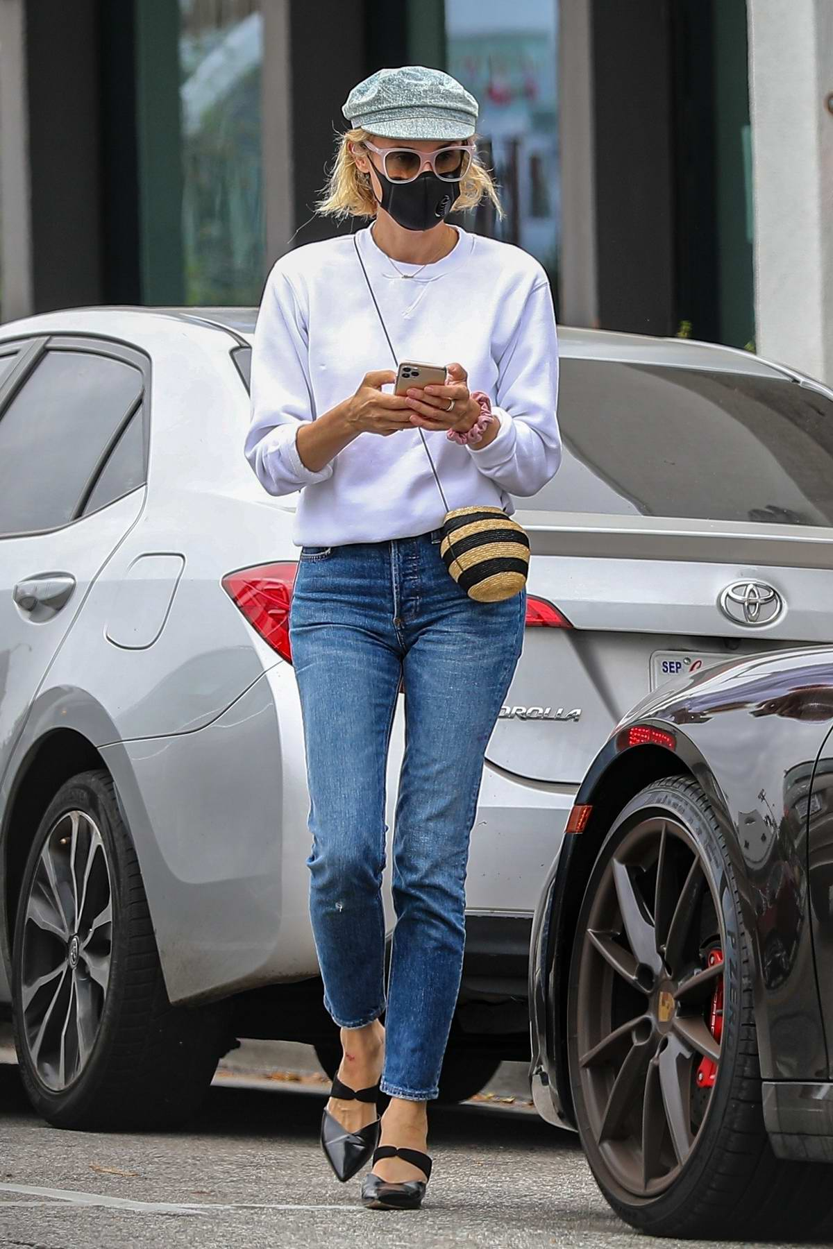 Diane Kruger wears a white sweater and jeans during a shopping trip in Brentwood, California