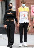 Dua Lipa and Anwar Hadid walk hand in hand after an al fresco lunch at Cafe Habana in New York City