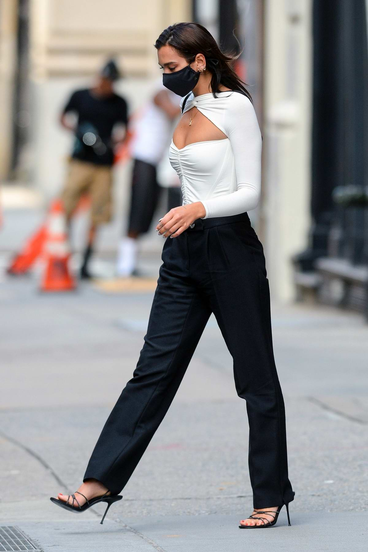 Dua Lipa sports a monochrome look as she steps out in the Greenwich Village of Manhattan in New York City