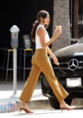 Eiza Gonzalez looks stylish in bell-bottoms while making an iced coffee run at Alfred's in Los Angeles