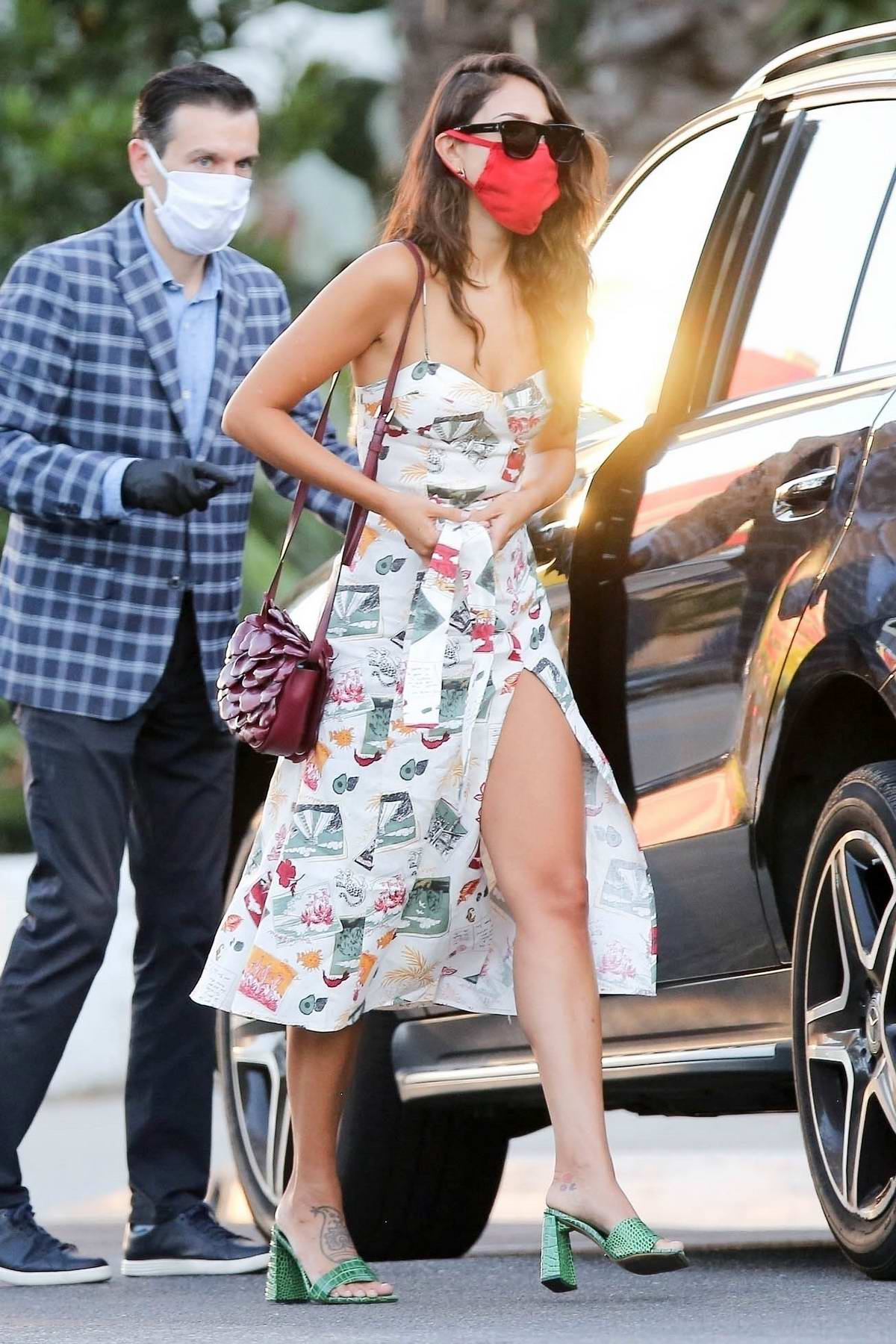 Eiza Gonzalez stuns in a colorful dress with green heels while arriving at San Vicente Bungalows in Los Angeles