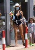 Elisabetta Canalis looks amazing in a black swimsuit while out with her daughter in Porto Rotondo, Italy