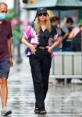 Elsa Hosk and Tom Daly get caught in a brief sunshower in New York City