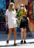 Elsa Hosk goes casual yet stylish while out buying a bouquet of sunflowers in New York City