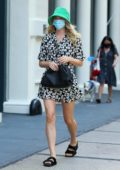 Elsa Hosk looks great in a summer dress and green bucket hat while heading to lunch in New York City