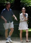 Emilia Clarke enjoys a walk at local park with her dog and Tom Turner in London, UK
