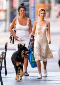 Emily Ratajkowski looks pretty in a summer dress while out to walk her dog with a friend in New York City