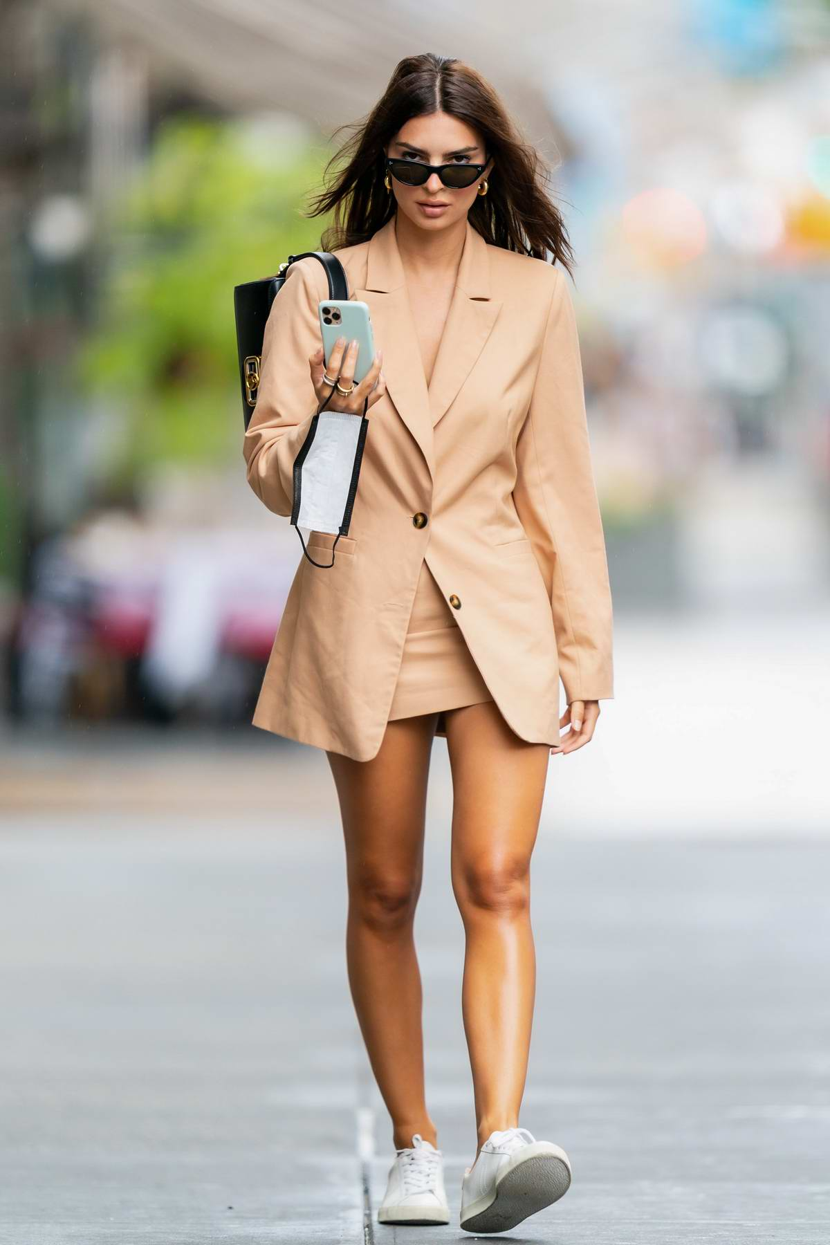Emily Ratajkowski looks stylish in a beige blazer and miniskirt while out on a solo stroll in New York City