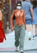 Emily Ratajkowski looks stylish in a sheer shirt while out for dinner in New York City