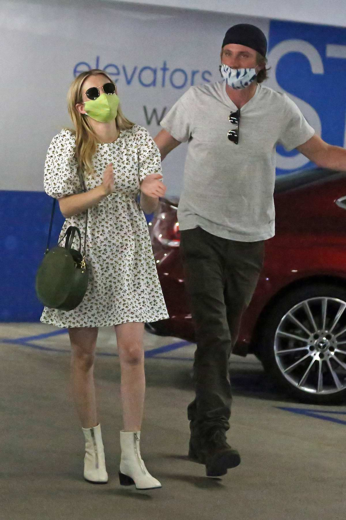 Emma Roberts and Garrett Hedlund seen leaving a medical building after a check up in Los Angeles