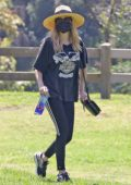 Emma Roberts wears a vintage Harley-Davidson tee and leggings with a fedora while making a coffee run in Los Angeles