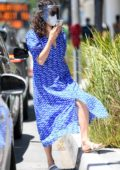 Emmy Rossum picks up some food to go wearing a bright blue colored dress in Beverly Hills, California