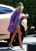 Hailey Bieber looks stylish in a purple duster and denim shorts as she arrives at The Hollywood Roosevelt in Los Angeles