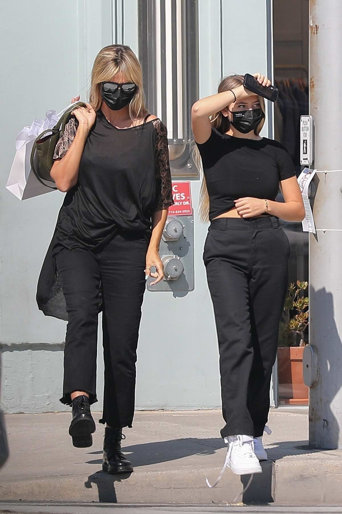 Heidi Klum dons all-black ensemble during a shopping trip with her daughter on Rodeo Drive in Beverly Hills, California