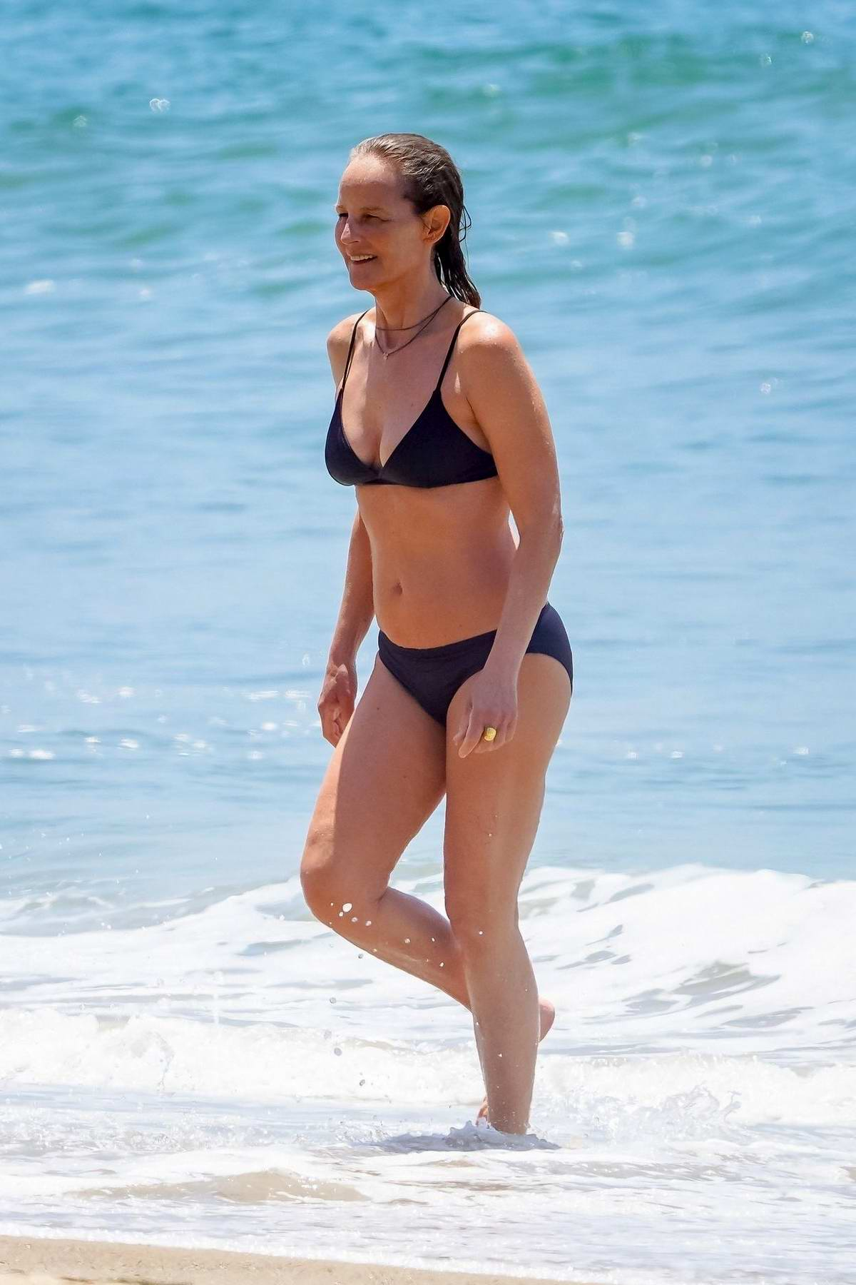 Helen Hunt wears a black bikini during a beach day in Malibu, California