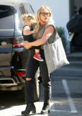 Hilary Duff carries her daughter as she leaves the Switch boutique in Bel-Air, California