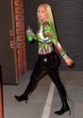 Iggy Azalea rocks black latex pants and a multi-color top to match her hair as she arrives a recording studio in Los Angeles