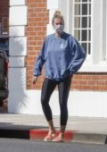 Ireland Baldwin keeps it casual in a sweatshirt and leggings while out with boyfriend Corey Harper in Los Angeles