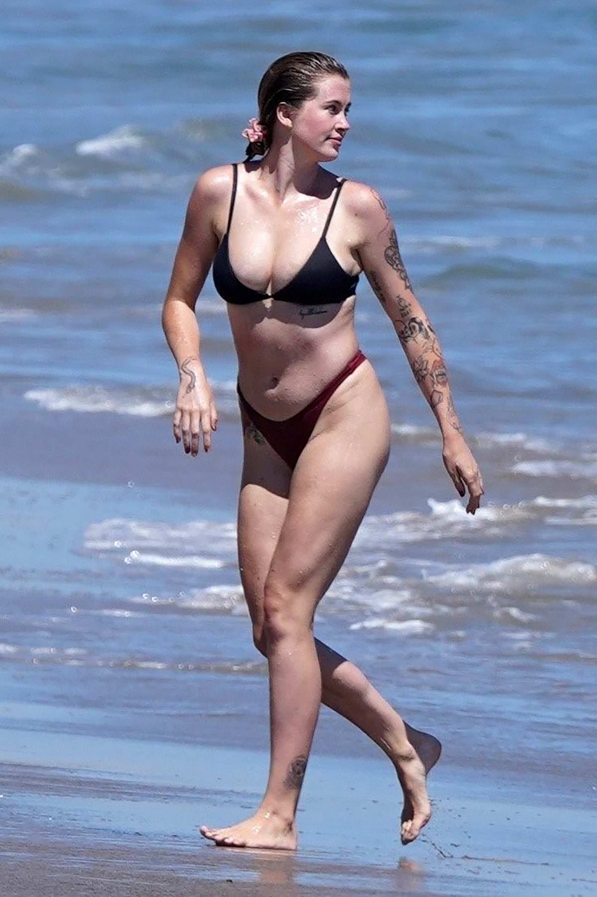 Ireland Baldwin seen wearing a bikini while enjoying a day with friends at the beach in Malibu, California