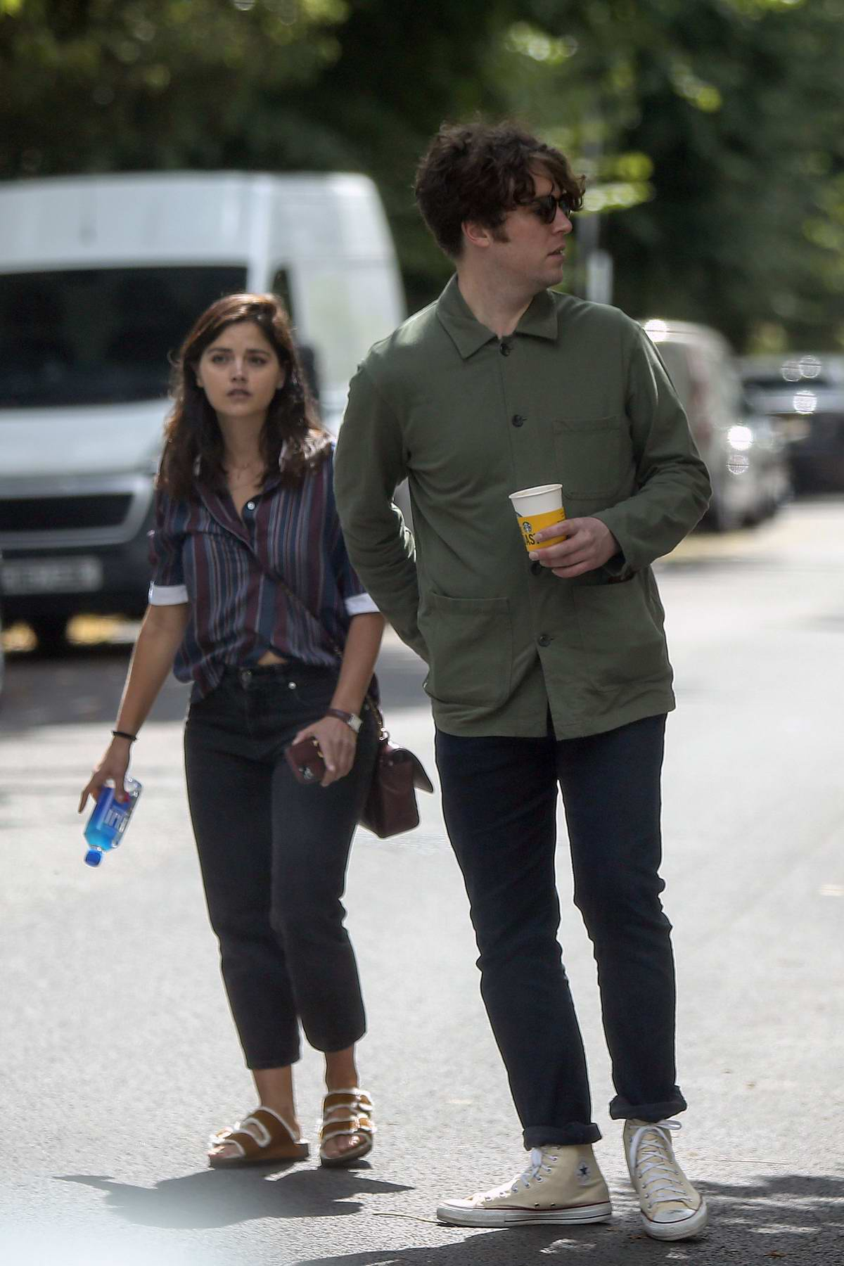 Jenna Coleman and Tom Hughes spotted together through the street in London, UK