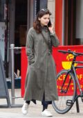 Jenna Coleman looked busy on her phone during a solo outing in London, UK