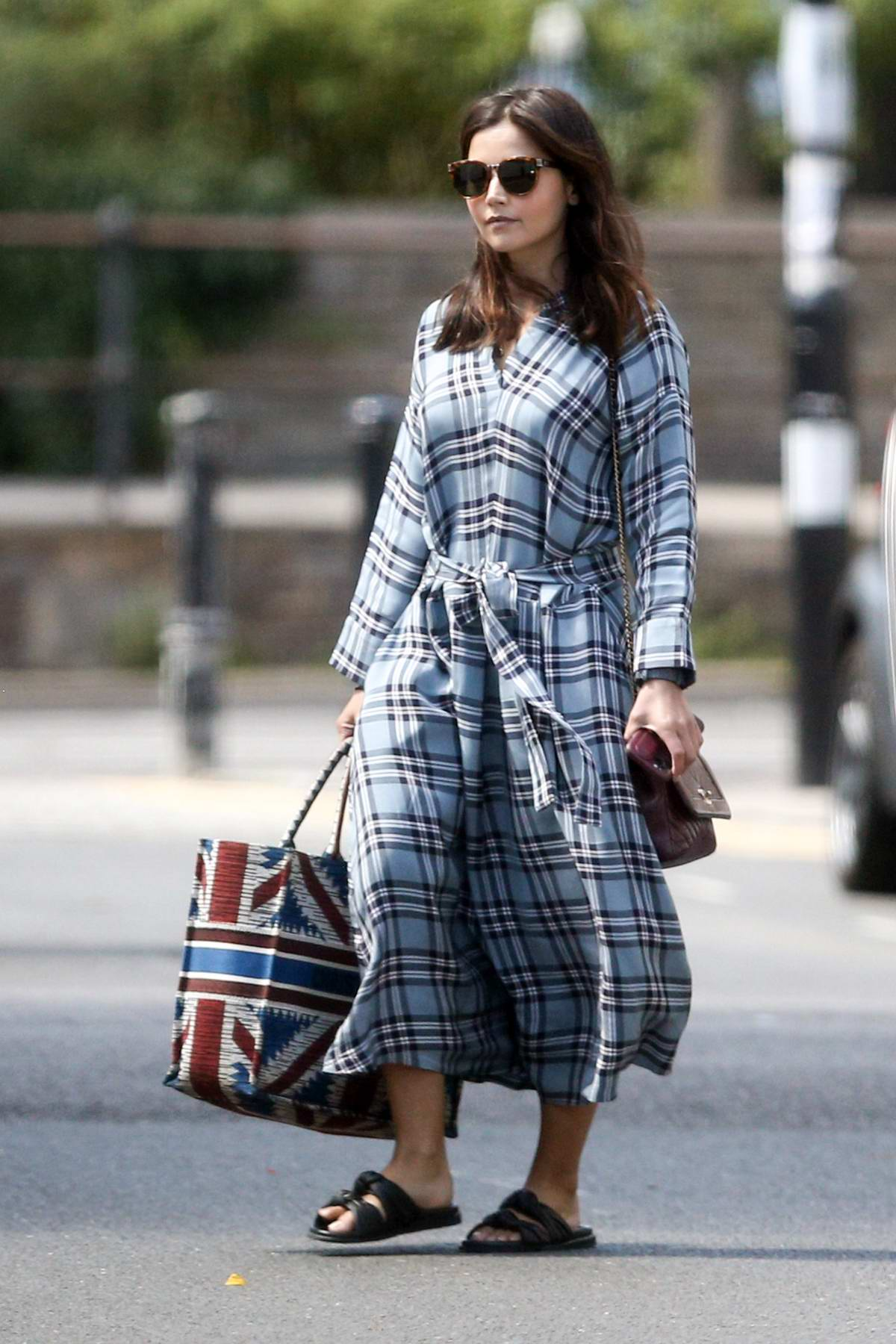 Jenna Coleman seen wearing a plaid robe dress as she leaves her new home in London, UK