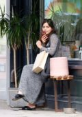 Jenna Coleman waits for her ride after shopping a vase in London, UK