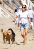 Jennifer Garner enjoys a walk with her family on the beach in Malibu, California