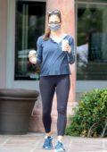 Jennifer Garner wears a blue top and leggings while making a coffee run at Starbucks in Malibu, California