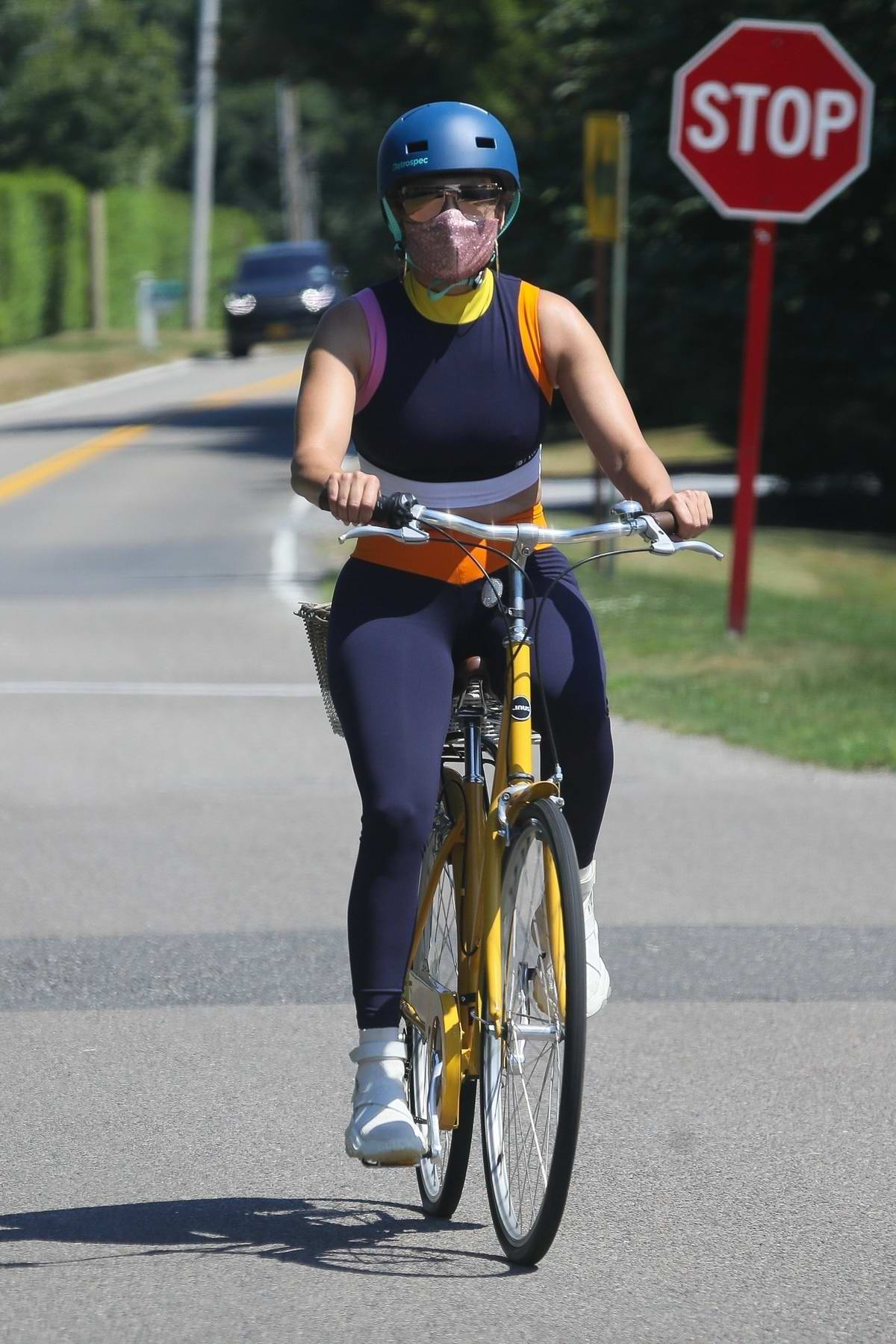 Jennifer Lopez hops on her cute yellow bike for a ride in The Hamptons, New York