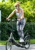 Jennifer Lopez sports a grey crop top and leggings while out on her ElliptiGo bike in Miami, Florida
