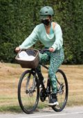 Jennifer Lopez sports a teal top with matching leggings during a bike ride around The Hamptons, New York