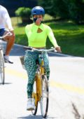 Jennifer Lopez sports a neon top and patterned leggings during a morning bike ride with Alex Rodriguez in the Hamptons, New York