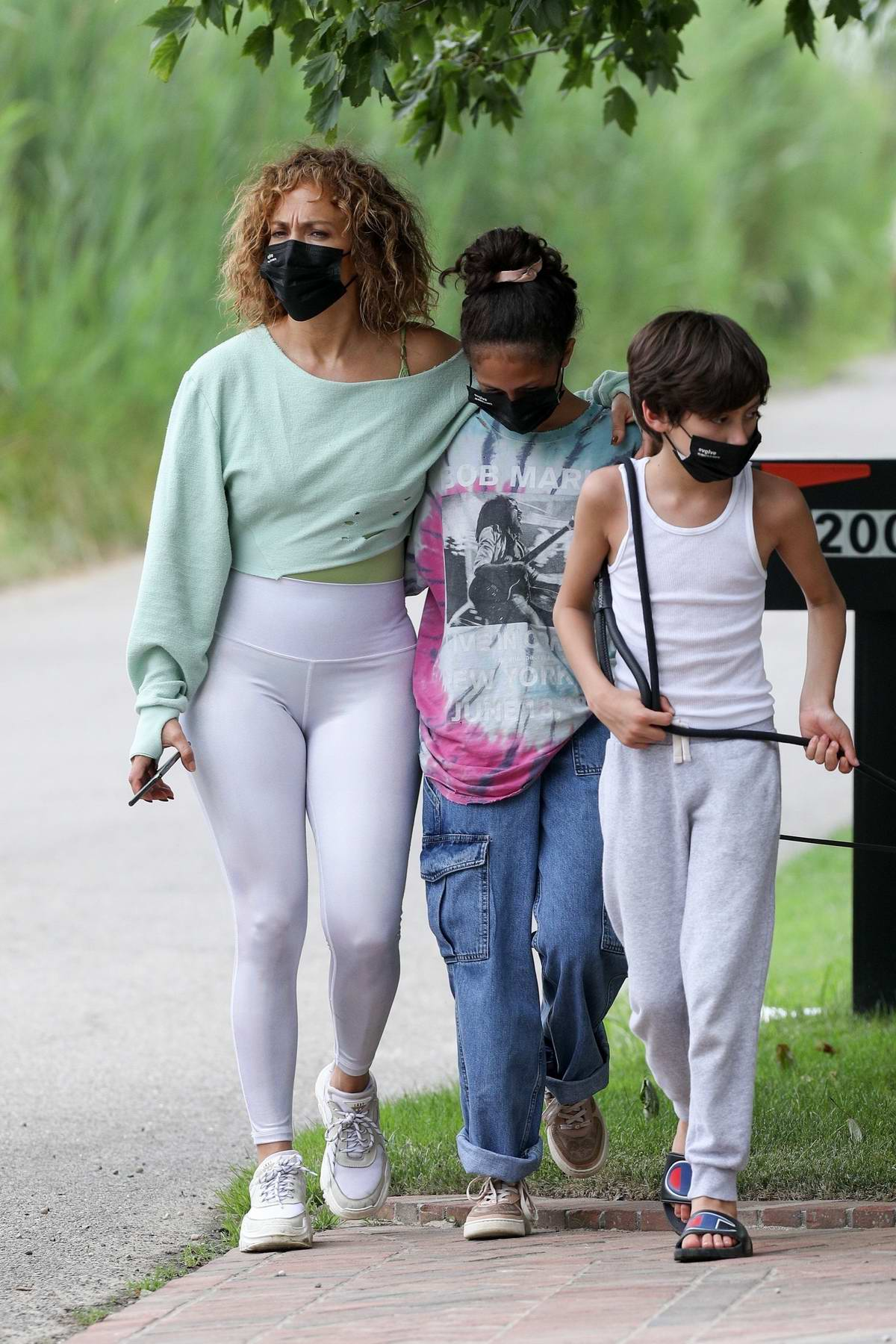 Jennifer Lopez wears a crop top and leggings while out for walk with her kids in the Hamptons, New York