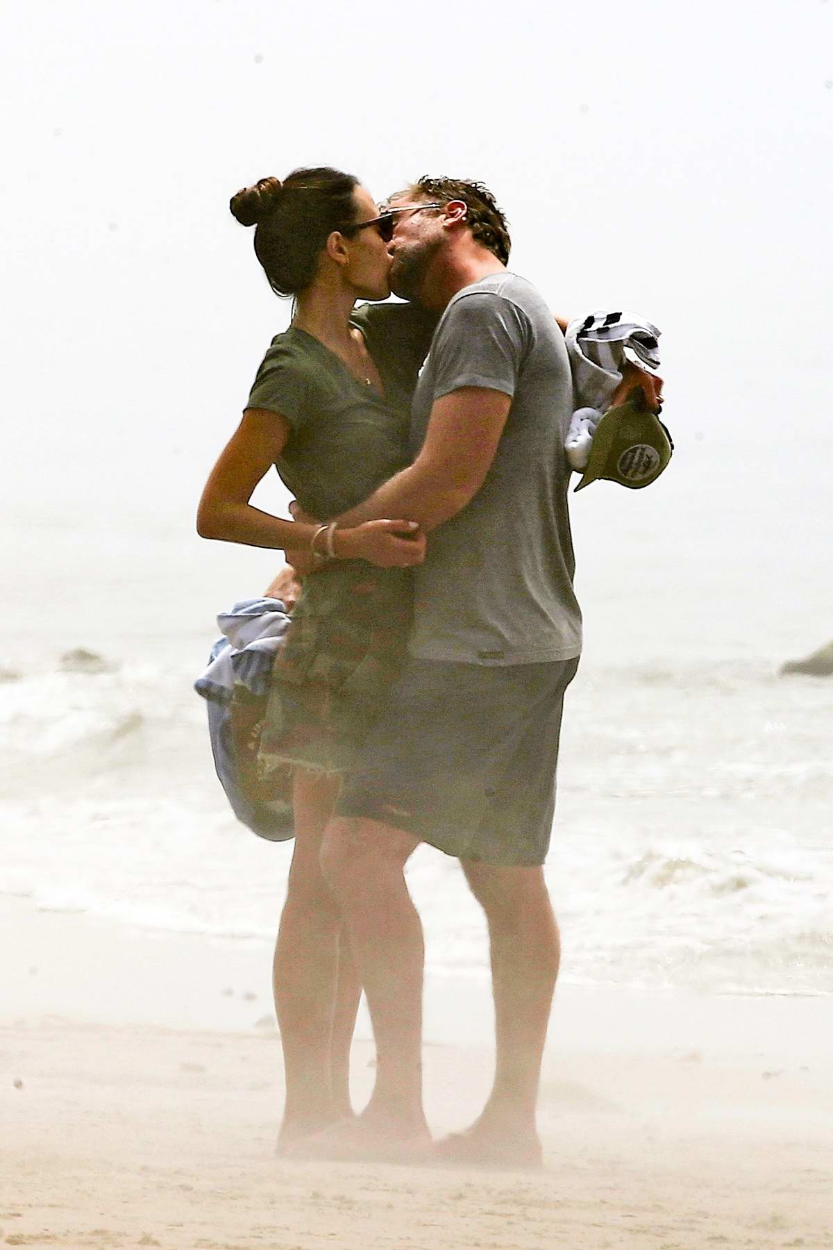 Jordana Brewster packs on some serious PDA with her new boyfriend during a romantic beach walk in Malibu, California