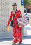 Jordana Brewster wears a bright red dress while grocery shopping at San Vicente food market in Brentwood, California
