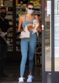 Kaia Gerber displays her stunning figure in a crop top and leggings while grabbing a juice after gym in West Hollywood, California