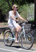 Karlie Kloss enjoys a bike ride with husband Joshua Kushner in Santa Monica, California