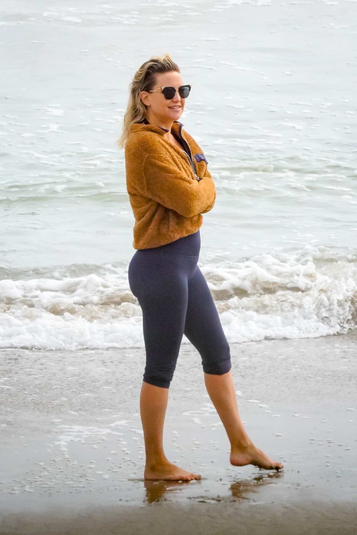 Kate Hudson enjoys a day at the beach with her family in Malibu, California