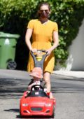 Kate Mara dons a cute summer yellow dress while taking her daughter out for a stroll in Los Feliz, California
